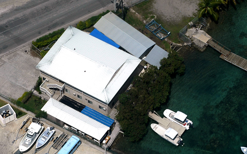 Palau: aerial view of CRRF lab site with 3 work boats