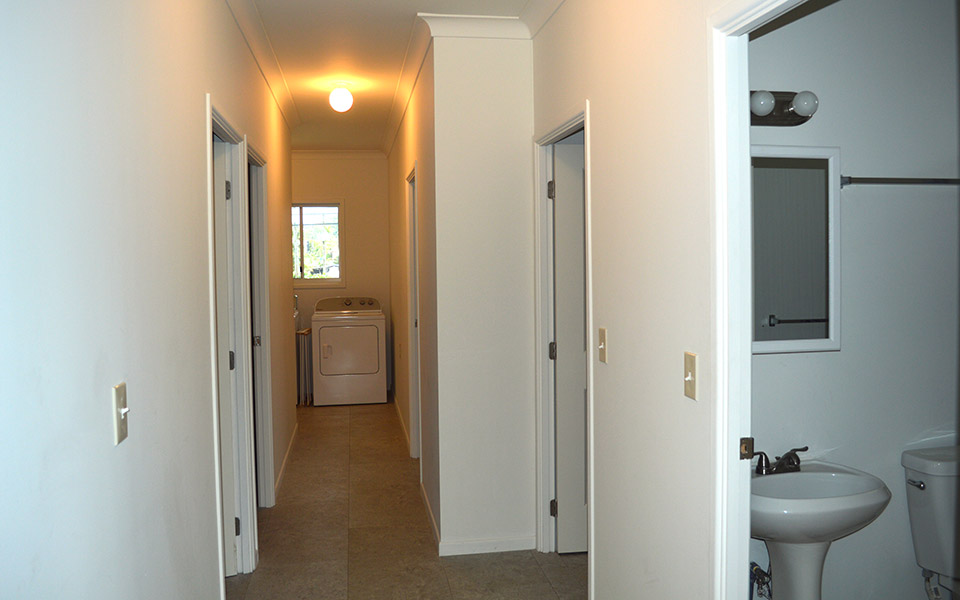 2 bathrooms on right, rooms down the hall